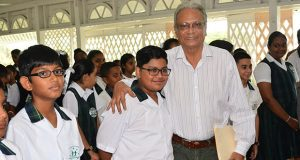 Education Minister, Dr Rupert Roopnaraine with Anthony Ferreira of Mae's Under-12 and other students at the school