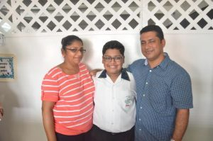 Anthony Ferreira of Mae's Under 12 with his parents shortly after the results were announced (Carl Croker photo)
